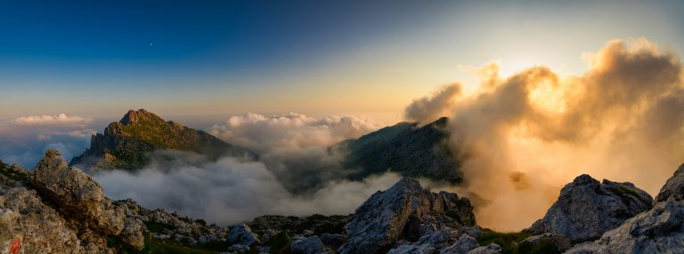 Sunrise mountain clouds trail running inversion rocky peaks